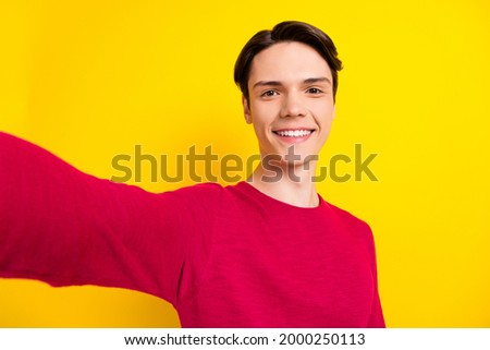 Photo of good brunet young guy do selfie wear red sweater isolated on yellow color background Stock photo ©