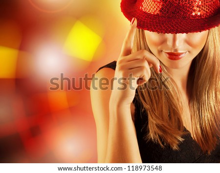Photo of gorgeous dancer female with finger up on the stage in disco club, closeup portrait of pretty blond woman isolated on shining background, night lifestyle, Christmas party, New Year eve