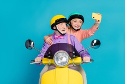 Photo of grey haired retired pensioner husband wife couple people wear helmet rider make selfie isolated on blue color background