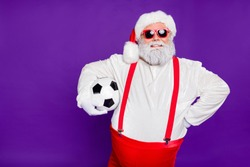 Photo of grey haired santa father holding football ball going to spend newyear night watching champion league wear sun specs costume isolated purple background