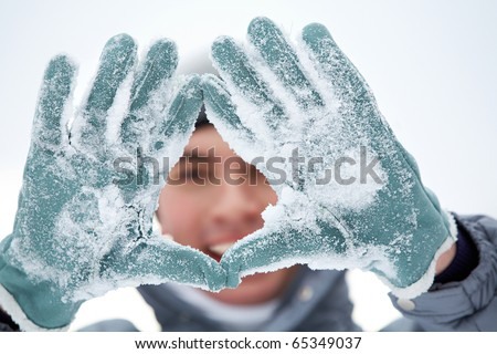 Photo of guy showing gloved hands covered with snow