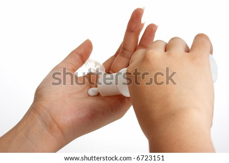 photo of hands putting lotion over a white background