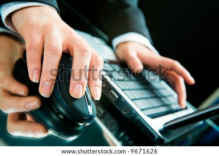 Photo of hands typing a letter on the laptop