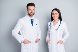 Photo of handsome doc guy practitioner experienced professional pretty lady two people patients consultation virology clinic good mood wear lab coats isolated grey color background