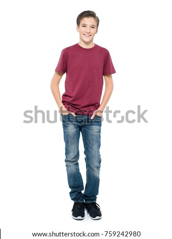 Photo of handsome teenage young guy - looking at camera. Full portrait of pretty boy.