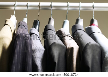 Photo of hangers with jackets of different colors on them
