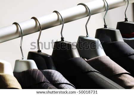 Photo of hangers with jackets on them in boutique