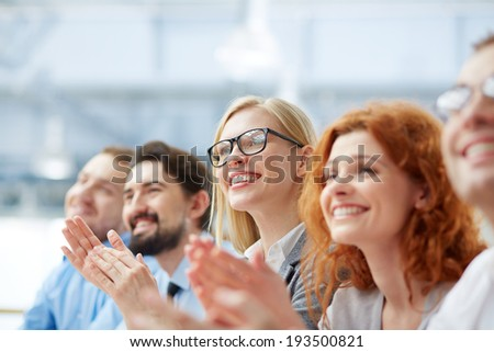 Photo of happy business people applauding at conference, focus on smiling blonde #193500821