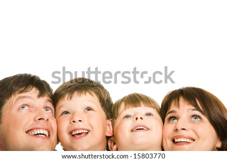 Photo of happy family looking upwards on white background