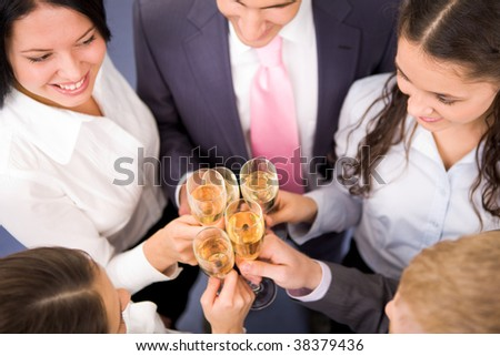 Photo of happy friends making toast during party