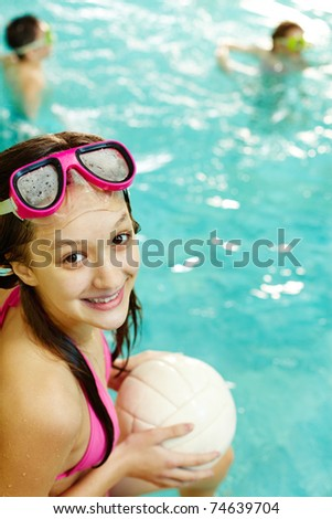 Photo of happy girl with ball smiling at camera