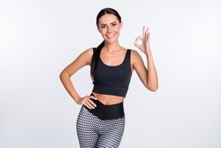 Photo of happy good mood smiling cheerful sportive athlete woman showing okay sign isolated on white color background
