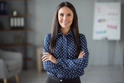 Photo of happy joyful confident young woman wear formalwear folded hands indoors in office workplace workstation