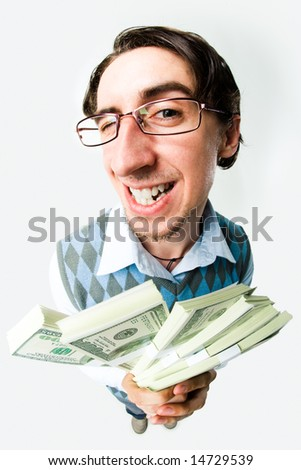 Photo of happy man holding packs of dollars in hands and looking at camera