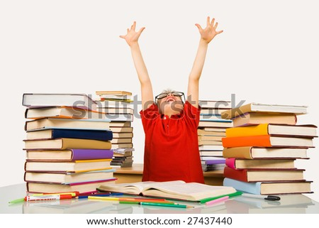 Photo of happy preschooler with his arms raised screaming in excitement