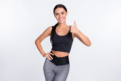 Photo of happy smiling beautiful sportive athlete woman showing thumb-up like isolated on white color background
