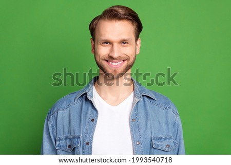 Photo of happy smiling cheerful good mood man with white teeth stomatology treatment isolated on green color background