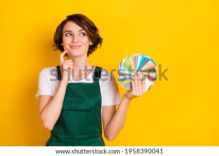 Photo of happy smiling good mood charming woman painter hold color palette dreaming isolated on yellow color background Stok fotoğraf ©