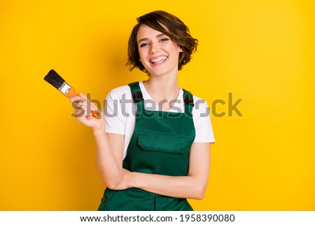 Photo of happy smiling good mood woman construction worker laughing hold paint brush isolated on yellow color background Stok fotoğraf ©