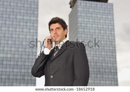 Photo of happy winner businessman  talking on mobile phone