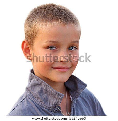 Photo of happy young boy looking at camera on white background