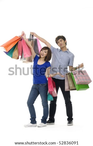 Photo of happy young couple with the shopping bags