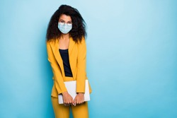 Photo of her she attractive chic classy lady agent broker real estate carrying laptop wearing safety gauze mask mers cov infection prevention stop pandemia isolated blue color background