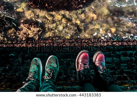 Photo of Hipster shoes above the water of San Francisco