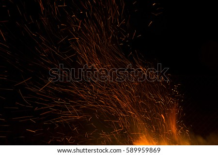Photo of hot sparking live-coals burning, spark of bonfire. #589959869