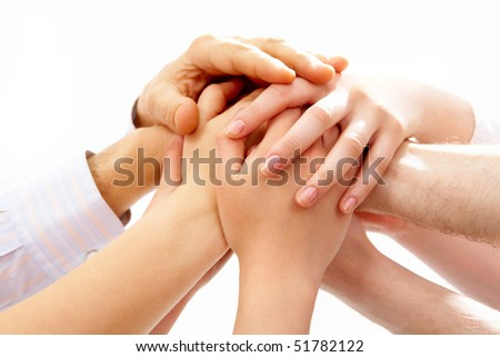 Photo of human hands on top of each other on a white background