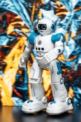 Photo of humanoid robot walking and dancing in neon light background