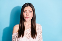 Photo of hungry excited young woman look empty space imagine yummy food isolated on blue color background