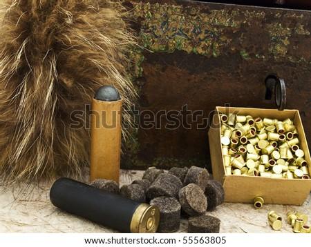 Photo of hunting theme with fox brush and gunpowder at beige