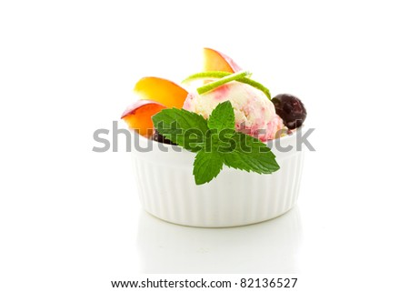 photo of Ice cream with fruits on isolated white background