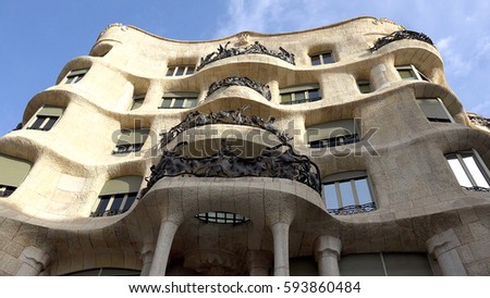 Shutterstock Photo of iconic Casa Mila on a sunny spring day, Barcelona, Spain