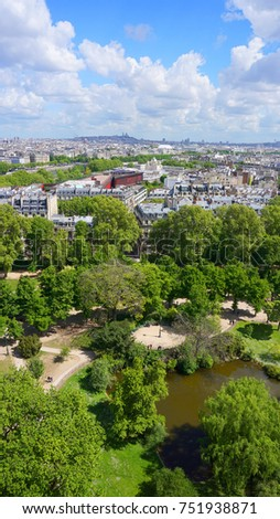Photo of iconic view of Champ de Mars from Eiffel Tower with beautiful scattered clouds on a spring morning, Paris, France