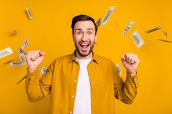 Photo of impressed lucky young gentleman dressed casual outfit win jackpot rising fists isolated yellow color background