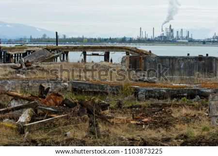 Photo of Industrial Wasteland with manufacturing plant in background.