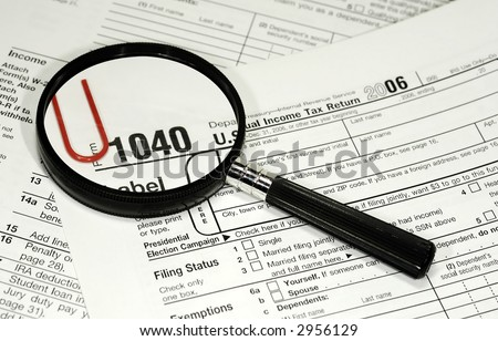 Photo of 1040 IRS form and a Magnifying Glass - Tax Related