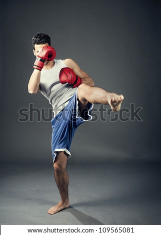 photo of kick boxer hitting with his feet
