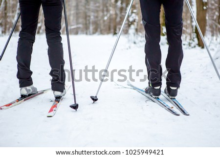 Photo of legs of two skiers in the winter #1025949421