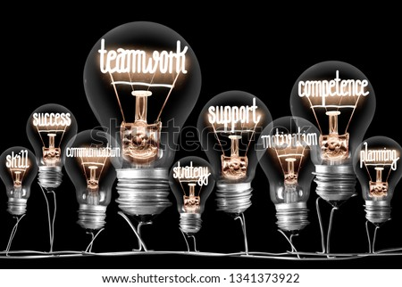 Photo of light bulbs group with shining fibers in a shape of Teamwork, Competence and Support concept related words isolated on black background #1341373922