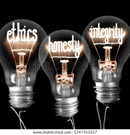 Photo of light bulbs with shining fibres in ETHICS, HONESTY and INTEGRITY shape isolated on black background #1247353267