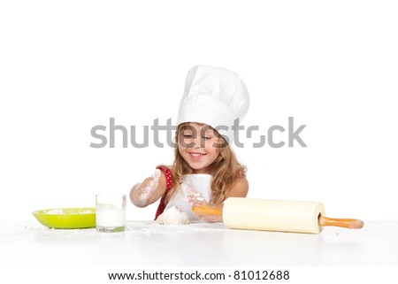 photo of little baker adorable, pretty little caucasian girl in chef hat, happy smile 4 year child mix dough, isolated over white background. Cooking concept.