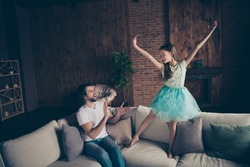 Photo of little energetic pretty lady excited handsome daddy watching daughter school dance performance sitting sofa clapping arms ovation house room indoors