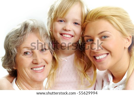 Photo of little girl with her grandmother and mother