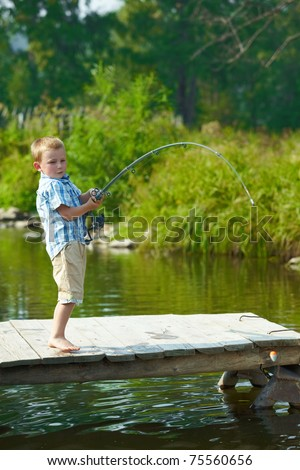 Photo of little kid pulling rod while fishing on weekend