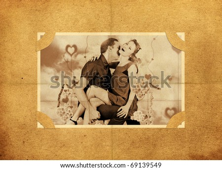 Photo of lovers on old, aged background paper