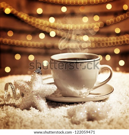 Photo of luxury white cup with tasty coffee, Christmastime table setting, tea mug on brown glowing background, festive star decoration, New Year ornament, Christmas home decor