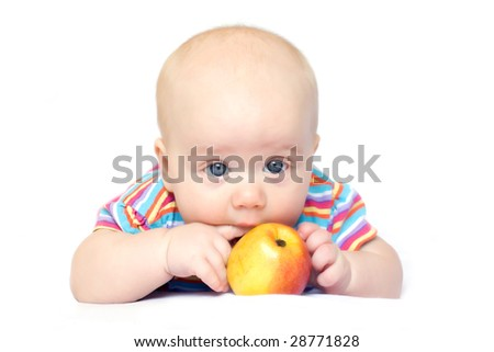 Photo of lying little boy with red-yellow apple